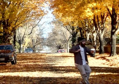 time-and-again-beautiful-fall-scenery-man-running-through-street